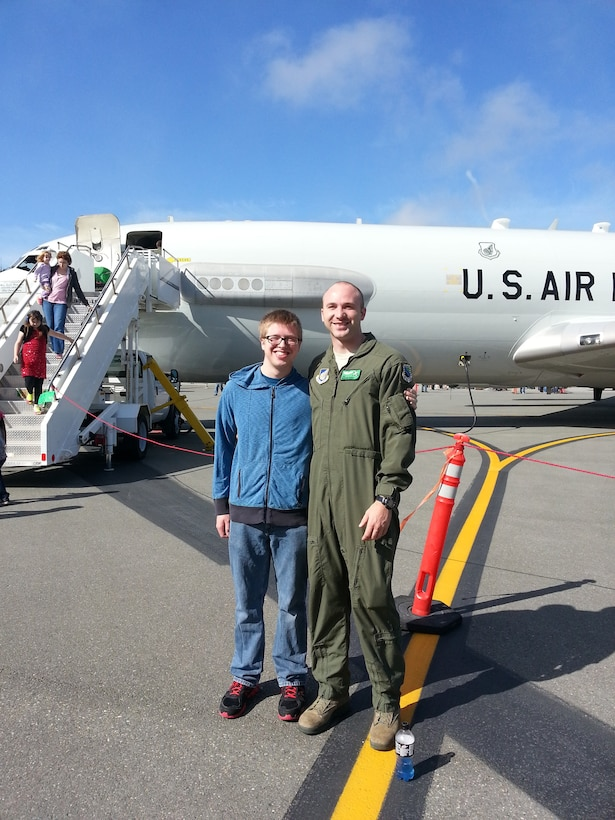 Senior Airman Madison Hayes, 962nd Airborne Air Control Squadron E-3 Sentry airborne mission systems specialist, poses for a photo with his brother Benjamin Hayes at the 3rd Wing Airshow at Joint Base Elmendorf-Richardson, Alaska, July 2014.