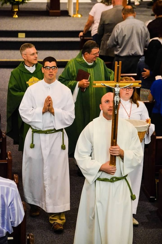 2nd. Lt. Madison Hayes, Air Force Reserve Command chaplain candidate, serves as an Acolyte for Catholic Mass during the Chaplain Candidate Intensive Internship program at Robins Air Force Base, Georgia, July 2016