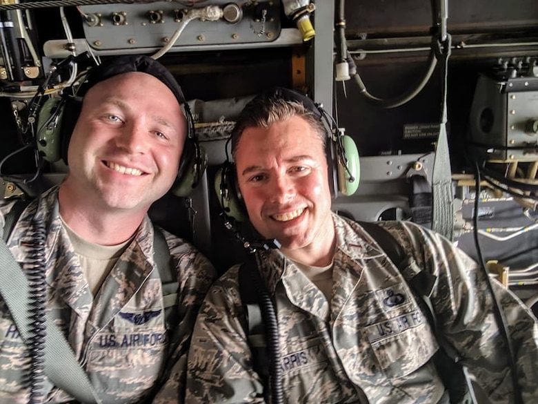 2nd. Lt. Madison Hayes, left, and 2nd. Lt. Tyler Harris, right, both Air Force Reserve Command chaplain candidates out of Robins Air Force Base, Georgia, pose for a photo during an incentive flight aboard a CV-22 Osprey during the Celebrate America festival at Yokota Air Base, Japan, July 2, 2019.