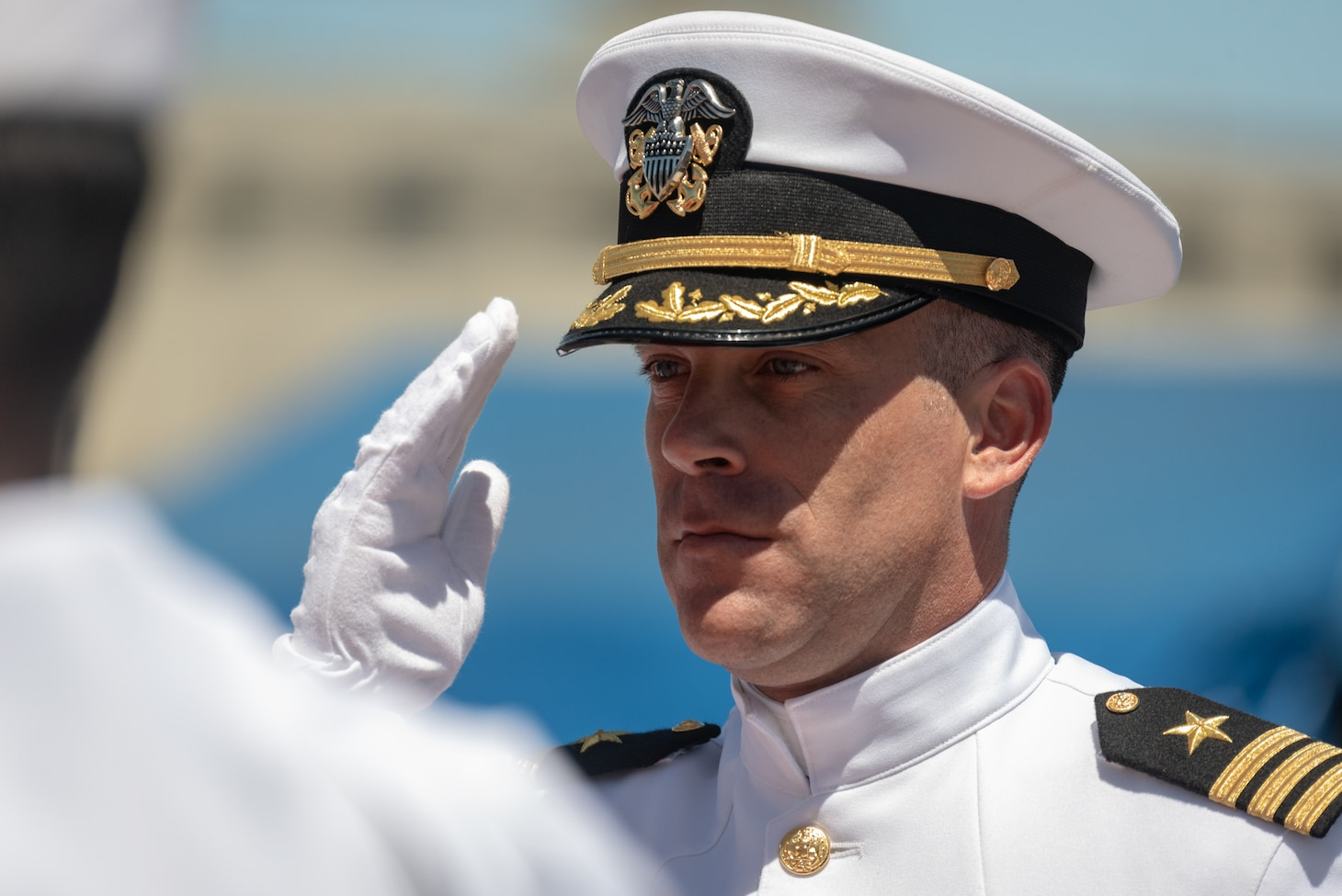 JOINT BASE PEARL HARBOR-HICKAM, Hawaii (May 31, 2019) Cmdr. Matthew Lewis is piped ashore after a change of command of the Virginia-class fast-attack submarine USS North Carolina (SSN 777)at Joint Base Pearl Harbor-Hickam, Hawaii, May 31. Cmdr. Matthew Lewis, commanding officer of North Carolina, was relieved by Cmdr. Michael Fisher, after more than 30 months in command of the vessel. (U.S. Navy Photo by Mass Communication Specialist 1st Class Daniel Hinton)