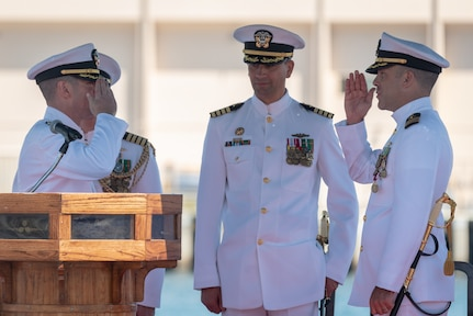 JOINT BASE PEARL HARBOR-HICKAM, Hawaii (May 31, 2019) Cmdr. Matthew Lewis (right) is relieved of command of the Virginia-class fast-attack submarine USS North Carolina (SSN 777), by Cmdr. Michael Fisher (left) during a change of command ceremony at Joint Base Pearl Harbor-Hickam, Hawaii, May 31. (U.S. Navy Photo by Mass Communication Specialist 1st Class Daniel Hinton)