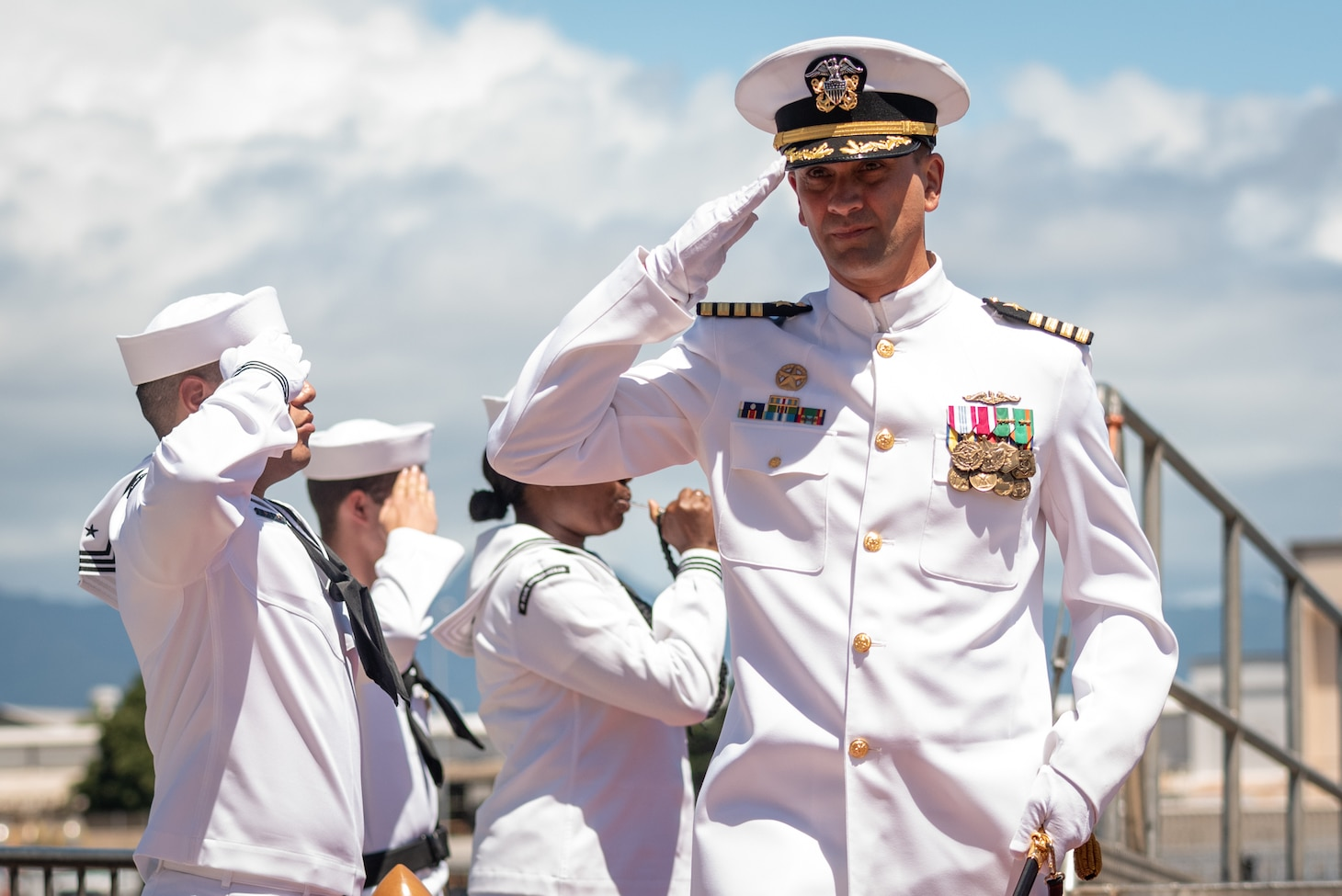 JOINT BASE PEARL HARBOR-HICKAM, Hawaii (May 31, 2019) Capt. Wes Bringham, commander, Submarine Squadron 1, is piped ashore after a change of command of the Virginia-class fast-attack submarine USS North Carolina (SSN 777)at Joint Base Pearl Harbor-Hickam, Hawaii, May 31. Cmdr. Matthew Lewis, commanding officer of North Carolina, was relieved by Cmdr. Michael Fisher, after more than 30 months in command of the vessel. (U.S. Navy Photo by Mass Communication Specialist 1st Class Daniel Hinton)