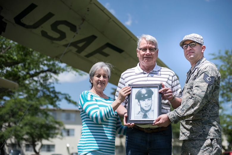 Jan Whitmore, left, a John Brown University fitness instructor, Eugene Whitmore, center, a United Natural Food Incorporate sales manager, and Tech. Sgt. Tyler Whitmore, right, the 35th Maintenance Group Air Force repair enhancement program manager, holds a photo of 1st David C. Clements in Risner Circle at Misawa Air Base, Japan, May 30, 2019. Clements, a 468th Strategic Fighter Squadron fighter pilot, passed away April 16, 1953, at 27 years, from an aircraft ejection malfunction. In his honor, his name is painted on the F-86F Sabre static display behind his family in this picture. (U.S. Air Force photo by Senior Airman Collette Brooks)