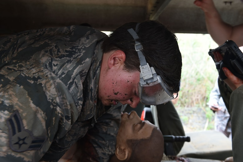 Airman First Class Samantha Brooner, aerospace medical technician, participates in the Tactical Casualty Combat Course (TCCC) at Naval Air Station I (NAS) Sigonella on May 14, 2019. The TCCC is an improved field care that helps field medics sharpen and hone their skills. (U.S. Air National Guard photo by Senior Airman Katelyn Sprott)