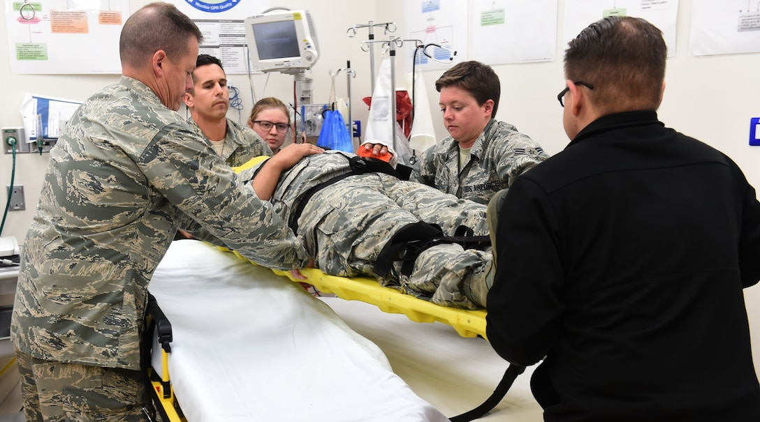 A group of aerospace medical technicians, practice how to properly unload a patient from the gurney to a hospital bed while maintaining stabilization at Naval Air Station I (NAS) Sigonella on May 16, 2019. This opportunity gives emergency room staff the chance to practice with a talking 'patient' in order to properly asses situations. (U.S. Air National Guard photo by Senior Airman Katelyn Sprott)