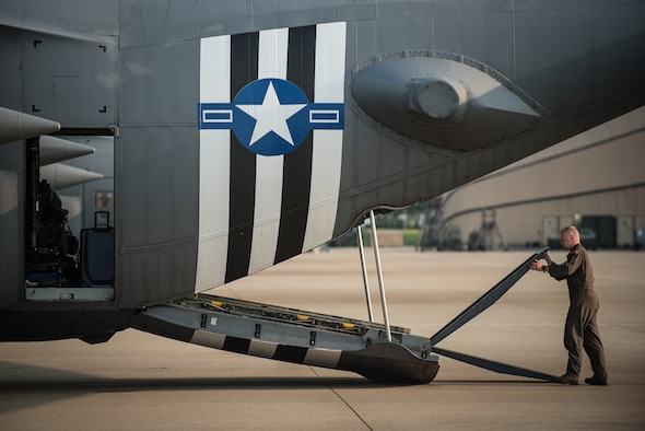 Senior Airman Brett Hook, a loadmaster for the 123rd Airlift Wing, closes the ramp on a C-130 Hercules aircraft at the Kentucky Air National Guard Base in Louisville, Ky., June 1, 2019, in preparation for a deployment to France. Hook and 30 other Kentucky Air Guardsmen will participate in the 75th-anniversary reenactment of D-Day there by airdropping U.S. Army paratroopers over Normandy on June 9. The aircraft has been striped with historically accurate Allied Forces livery in honor of the event, which turned the tide of World War II in the European theater. (U.S. Air National Guard photo by Dale Greer)