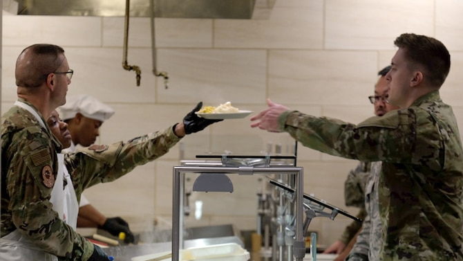 Col. Phil Heseltine, 931st Air Refueling Wing commander, and Chief Master Sgt. Takesha Williams, 931st ARW command chief and 507th Air Refueling Wing budget analyst, serve lunch to Team McConnell Airmen June 1, 2019, in the Chisholm Trail Dining Facility on McConnell Air Force Base, Kan.