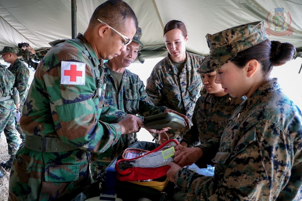 Military personnel conduct medical operations.