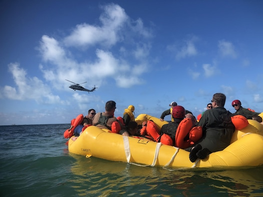 Reserve Citizen Airmen from Joint Base Charleston's 315th Airlift Wing participate in a water survival training event held at Naval Air Station Key West, Fl., May 31, 2019. Airmen were taken by boat into open water, far from shore where a MH-60 Seahawk helicopter hoisted them individually out of the water using a rescue basket. (U.S. Air Force photo by Senior Airman William Brugge)