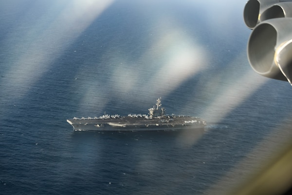 A photo of USS Abraham Lincoln taken from a B-52 in air.