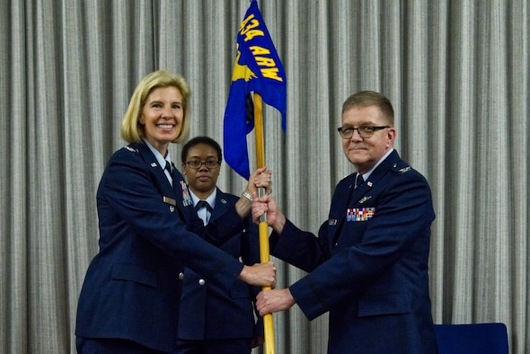 Col. Gregory Pinnell, 434th Aerospace Medicine Squadron commander, accepts the guidon from Col. Anne Noel, 434th Air Refueling Wing vice commander, at a change of command ceremony at Grissom Air Reserve Base, Indiana, June 1, 2019. Pinnell is filling the position left by the previous AMDS commander, Lt. Col. Pete Weber. (U.S. Air Force photo / Airman 1st Class Harrison Withrow)