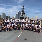 The Mission2Alpha team poses for a photo May 4, 2019, on board the U.S.S. Midway, San Diego.