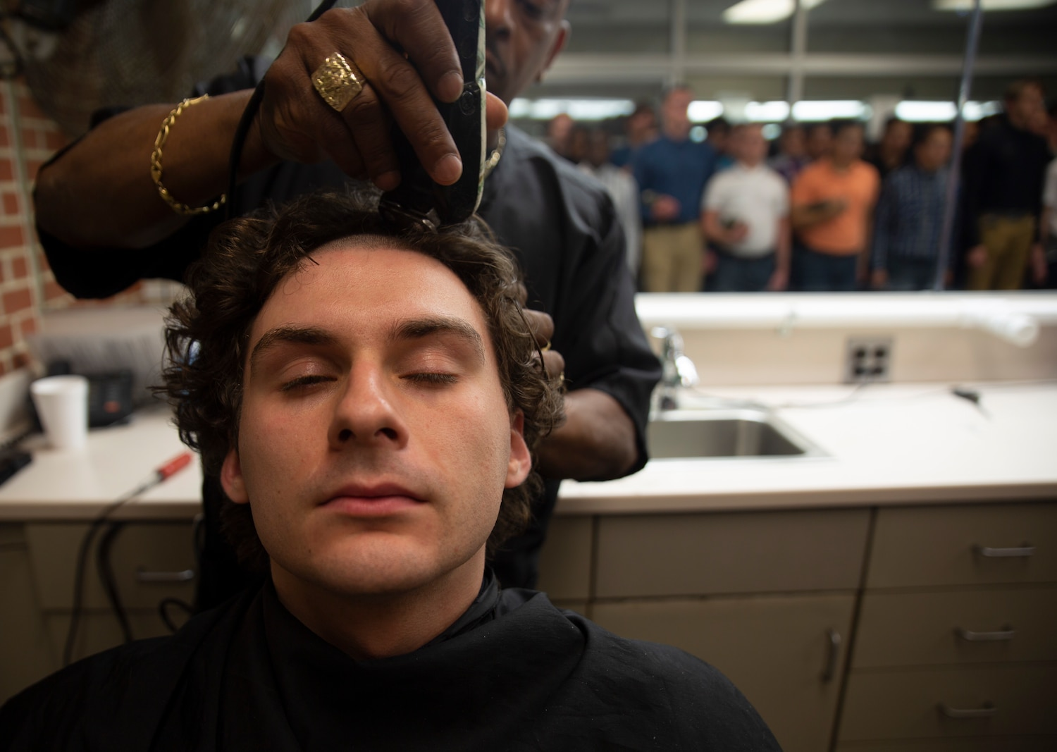 Rct. Joshua Ebbe, from Utica, N.Y., a new recruit with Fox Company, Second Recruit Training Battalion, receives his first haircut during receiving at Parris Island, S.C., on May 20th, 2019. During their first night on the island, recruits are issued gear and uniforms and process in their medical and dental records before being assigned to temporary drill instructors.