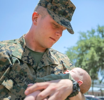 Pvt. Hunter Willmon, a Scottsboro, Ala. native, held his son for the first time on Family Day, May 26. Willmon graduated today from recruit training.