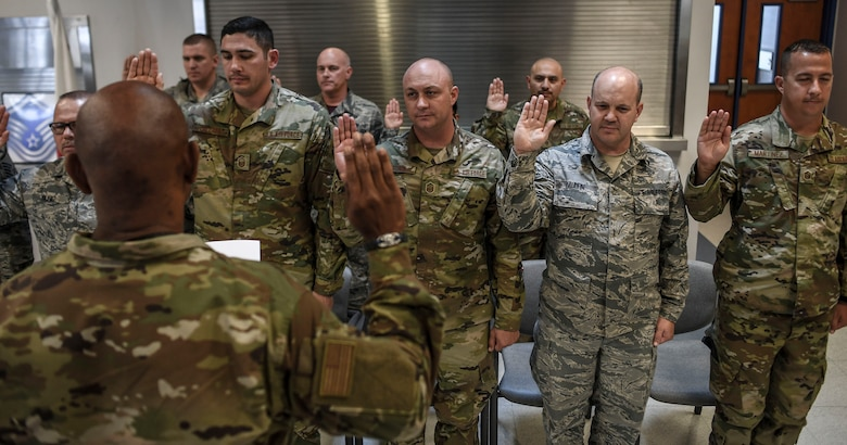 Chief Master Sgt. Adrian Davis administers the Senior Non-Commission Officer's Oath to the most recently promoted master sergeants of the 144th Fighter Wing during an induction ceremony at the Fresno Air National Guard Base, California, June 1, 2019