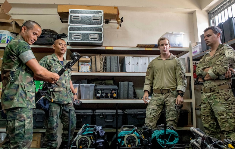 190531-N-RM689-1050 SATTAHIP NAVAL BASE, Thailand (May 31, 2019) Explosive ordnance disposal technicians assigned to U.S. Navy Explosive Ordnance Disposal Mobile Unit (EODMU) 5 and the Royal Thai Navy Diver and Explosive Ordnance Disposal Center conduct an equipment demonstration during a knowledge exchange as part of Cooperation Afloat Readiness and Training (CARAT) Thailand 2019. This year marks the 25th iteration of CARAT, a multinational exercise series designed to enhance U.S. and partner navies' abilities to operate together in response to traditional and non-traditional maritime security challenges in the Indo-Pacific region.