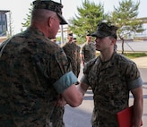 CAMP HUMPHREYS, Republic of Korea – Sgt. Nathaniel Hanscom, communication strategy and operations NCO for U.S. Marine Corps Forces Korea, is awarded the Navy and Marine Corps Achievement Medal here, June 3rd. Hanscom was awarded for his contributions to MARFORK as a photographer for the unit, telling of its history and story, as well as documenting and archiving events for the unit. (Official U.S. Marine Corps photo by 1stLt. Edward Pingel/Released)