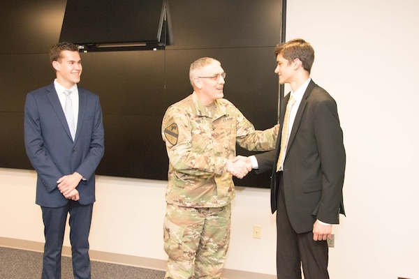 Colonel Stephen Bales, Middle East District Commander, congratulates Derek Sprincis and  Matthew Flacksenburg on the successful completion of their high school engineering and project management internships.  The Middle East District's high school intern program is dedicated to sparking an interest in U.S. Army Corps of Engineers positions for future generations of bright and driven individuals with an interest in STEM and/or project management.