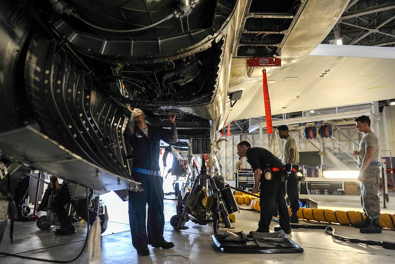 Maintainers from the 18th Equipment Maintenance Squadron and the 44th Air Maintenance Unit, inspect an F-15 Eagle during phase maintenance at Kadena Air Base, Japan, May 15, 2019.