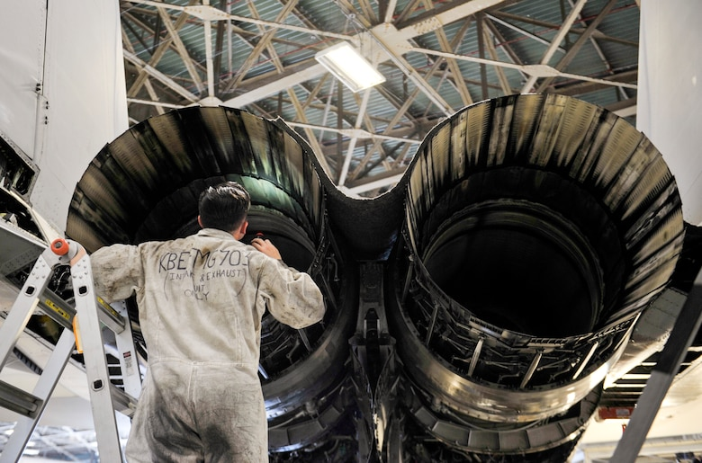U.S. Air Force Airman 1st Class Shawn McMahon, engine specialist assigned to the 44th Air Maintenance Unit, inspects the inside of an F-15 Eagle during phase maintenance at Kadena Air Base, Japan, May 15, 2019.