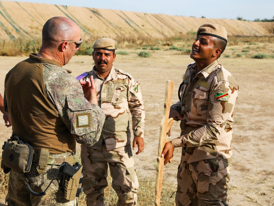 A New Zealand soldier with Task Group Taji 8, explains tactical field care techniques, on Camp Taji, Iraq, May 6, 2019. Combat Life Saver training builds soldier's confidence in providing efficient lifesaving measures in potentially hostile situations. Combined Joint Task Force – Operation Inherent Resolve focuses on providing training, support, and equipment to enhance the professionalism, technical expertise and equipment capabilities of Iraqi Security Forces. This will enable the ISF to counter future external and internal threats independently and establish permanent security across the country. (Portions of this photo have been blurred to protect operational security).