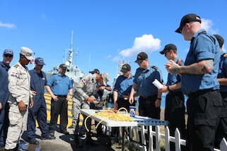 A Dominican Naval member competes in the Seamanship Olympics at Tradewinds 2019.