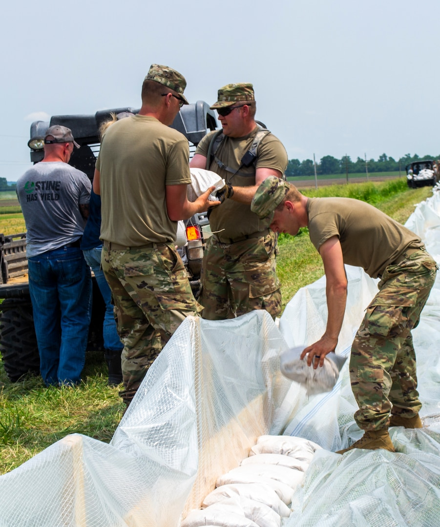 Soldiers are placing sandbags along the Winchester levee system