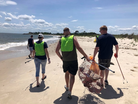 Thirteen Airmen from the 718th Intelligence Squadron participated in a community outreach project with the Hampton Clean City Commission. In honor of Earth Day, they coordinated a beach cleanup for the Grandview Island Nature Preserve in Hampton. The team collected three bags of trash and removed several large crab traps and other large items and debris.