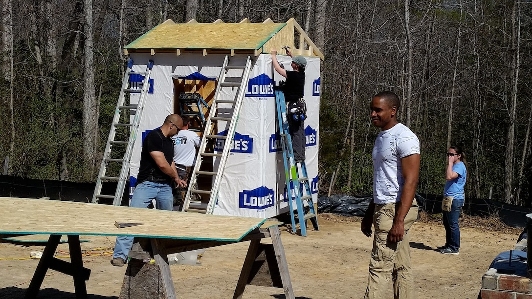 Seven Airmen from the 718th Intelligence Squadron helped build three homes for Habitat for Humanity. They installed roofing, built frameworks, put up sheetrock, completed siding work, and did work on metal trimming.