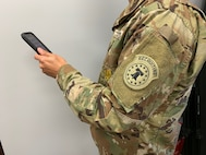 Soldier holding phone.