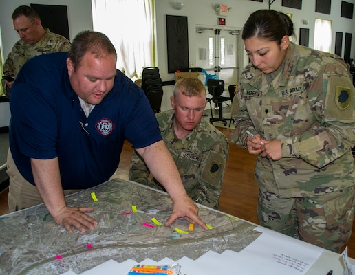 Spec. Jacqueline Herrera, of Cicero, Illinois, and Sgt. Andrew Gray, of Warren, Illinois. Herrera and Gray are among the 10 Soldiers from 2nd Battalion, 123rd Field Artillery Regiment working flood duty in the East Carondelet, Illinois area.