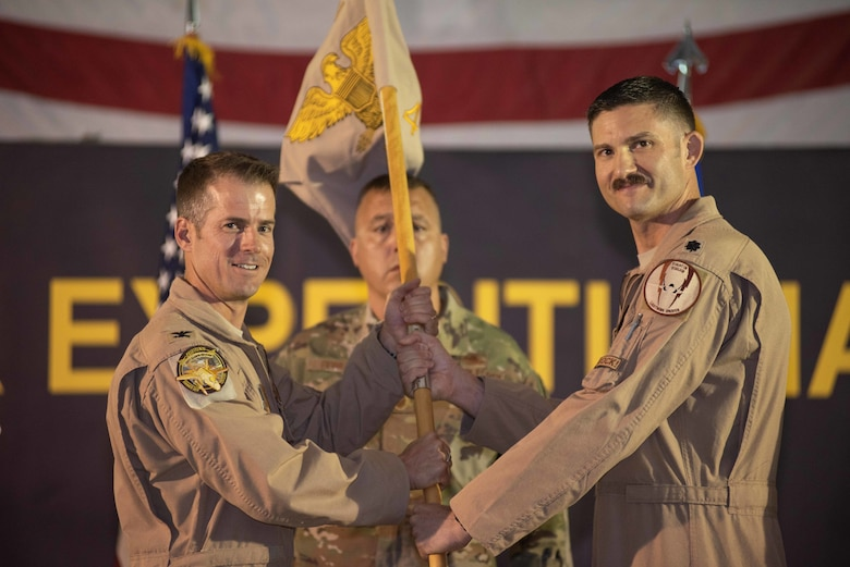 Lt. Col. Yosef Morris, right, relinquishes command of the 4th Expeditionary Fighter Squadron May 30, 2019 at Al Dhafra Air Base, United Arab Emirates. Morris served as the commander during the beginning of the F-35A Lightning II squadron's first deployment to the Middle East. (U.S. Air Force photo by Staff Sgt. Chris Thornbury)