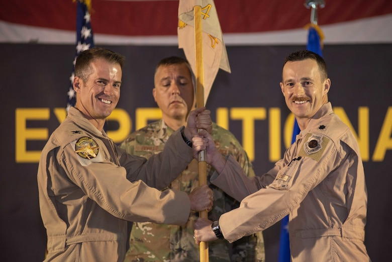 Lt. Col. Joshua Arki, right, takes command of the 4th Expeditionary Fighter Squadron May 30, 2019 at Al Dhafra Air Base, United Arab Emirates. Arki will serve as the commander for the remainder of the F-35A Lightning II squadron's first deployment in the Middle East. (U.S. Air Force photo by Staff Sgt. Chris Thornbury)