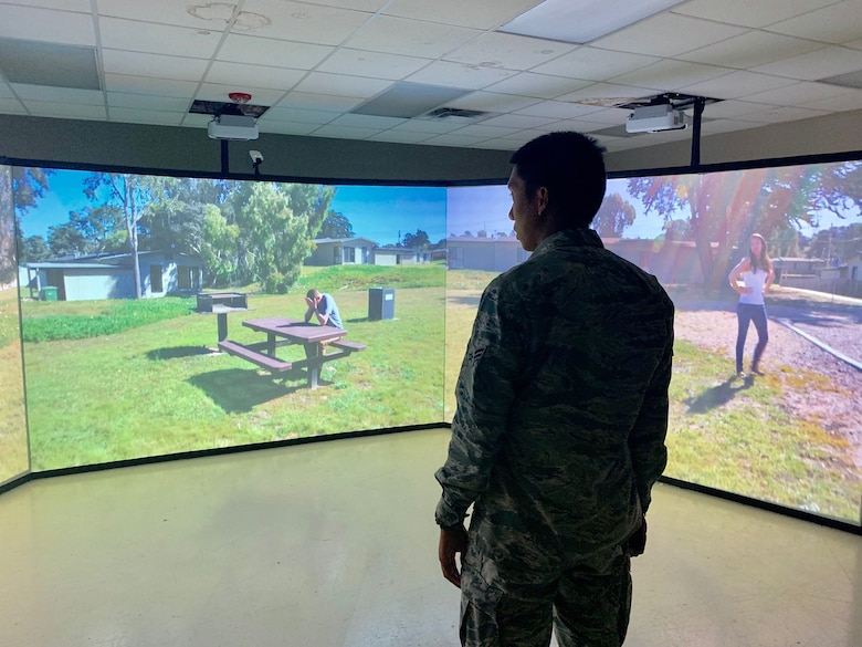 Airman 1st Class Valric Suyom, a recent graduate of the Security Forces apprentice course, participates in a use of force training scenario in the Multiple Interactive Learning Objectives (MILO) simulator at Joint Base San Antonio-Lackland, Texas, May 29, 2019. The 343rd Training Squadron has six MILO systems in place at the JBSA-Lackland Medina Annex training campus, including two 180-degree video theater systems, as well as four single-screen systems. (U.S. Air Force photo by Dan Hawkins)