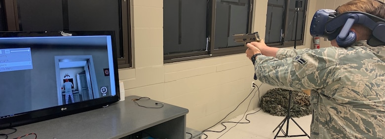 Airman 1st Class Taylor Waldron, a recent graduate of the Security Forces apprentice course, participates in a use of force training scenario in a virtual reality environment simulator at Joint Base San Antonio-Lackland, Texas, May 29, 2019. The 343rd Training Squadron has added the VR training simulators as part of a beta-test in conjunction with a civilian vendor at no cost to the unit through a partnership with AFWERX.  (U.S. Air Force photo bu Dan Hawkins)