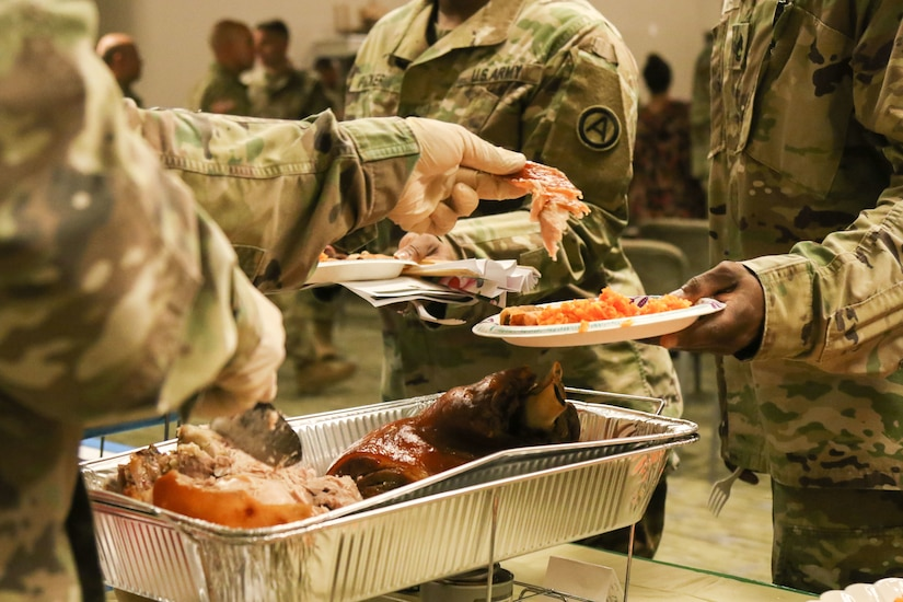 Members of U.S. Army Central try traditional Asian and Pacific Islander food during the annual Asian American Pacific Islander heritage observance at USARCENT's headquarters, Patton Hall, Shaw Air Force Base, S.C., May 15, 2019. Throughout the ceremony, traditional dances from the islands of Hawaii, Tahiti and Tonga were performed.