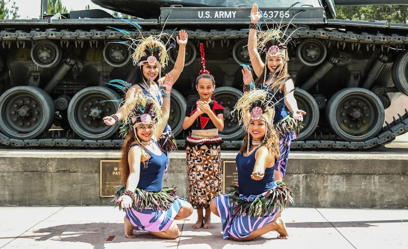 """The """"Island Beauties"""", a local Polynesian dance group, posed for a photo after U.S. Army Central's annual Asian American Pacific Islander heritage observance at USARCENT's headquarters, Patton Hall, Shaw Air Force Base, S.C., May 15, 2019. Members of USARCENT also prepared a """"Taste of the Pacific and Asia"""" food sampling for attendees to enjoy and experience."""
