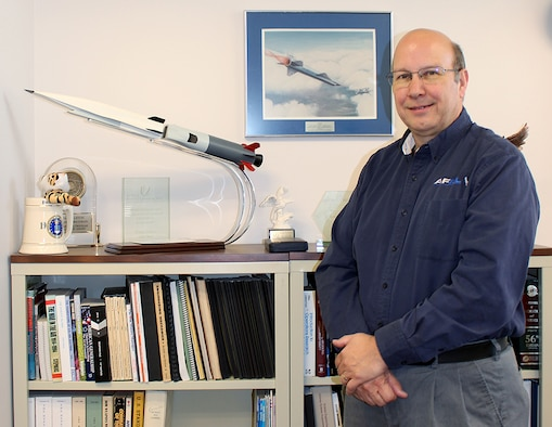Glenn Liston, chief of the U.S. Air Force Research Laboratory High Speed Experimentation Branch at Arnold Air Force Base, stands by a model of the X-51A WaveRider, an experimental, scramjet-powered hypersonic vehicle. In addition to his other career milestones, Liston said he is most proud of his involvement in the development of the aircraft. He will be retiring from Air Force civilian service June 30 after 37 years of federal service. (U.S. Air Force photo by Deidre Ortiz)