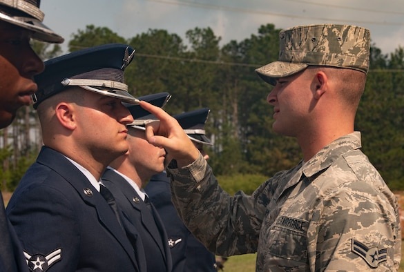 Airman 1st Class Connor Camatti, United State Air Force Honor Guard ceremonial guardsman, inspects Honor Guard trainees at Shaw Air Force Base, S.C., May 21, 2019.