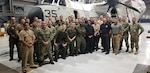 Navy and DLA members pose for photo after expediting a part