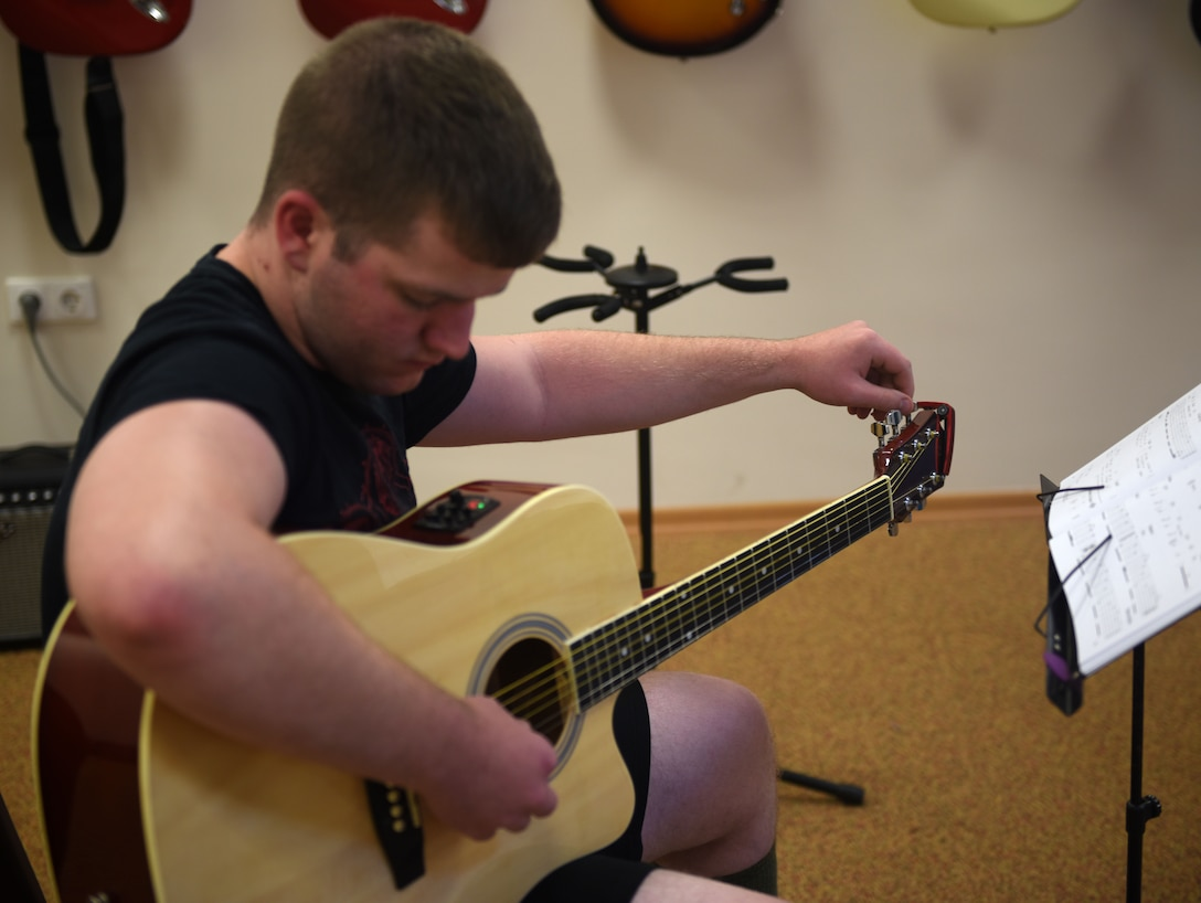 Airman 1st Class Colton Harris, 39th Communications Squadron client systems technician, tunes a guitar prior to the class held May 29, 2019, at Incirlik Air Base, Turkey. Harris started instructing the class in April to share his passion for music with other Airmen. (U.S. Air Force photo by Staff Sgt. Trevor Rhynes)