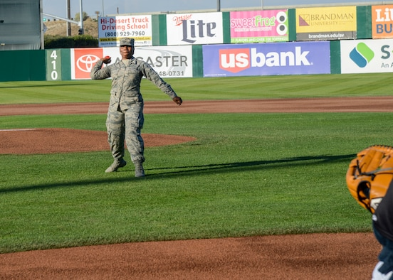 Senior Airman Mutia Graham, 412th Aerospace Medicine Squadron, throws the ceremonial first pitch during the Lancaster Jethawk's Aerospace Appreciation Night, at the Hangar baseball stadium in Lancaster, Calif., May 31. (U.S. Air Force photo by Giancarlo Casem)