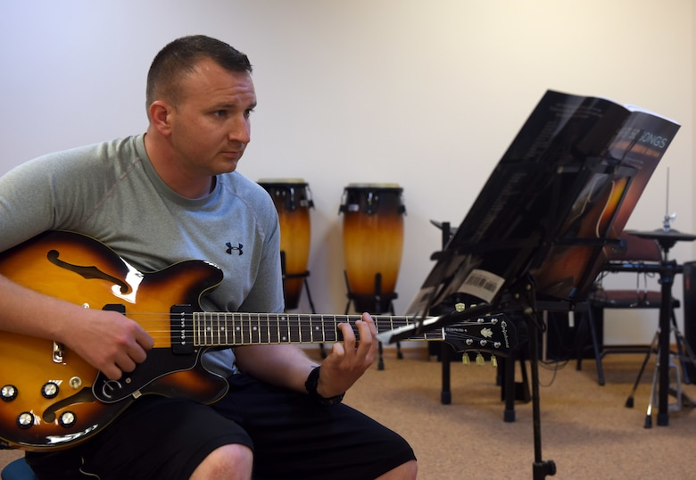 Tech. Sgt. David Eash, 39th Security Forces Squadron flight sergeant, plays a guitar during class May 29, 2019, at Incirlik Air Base, Turkey. Ranging from spin class to painting lessons, Airmen help one another pick up new hobbies and life skills during their time at Incirlik. (U.S. Air Force photo by Staff Sgt. Trevor Rhynes)
