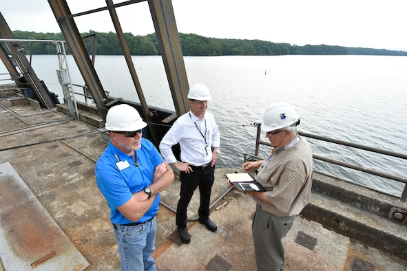 Dick Nugent, right, the Safety, Health and Environment manager for National Aerospace Solutions, the Test Operations and Sustainment contractor at Arnold Air Force Base, conducts a safety walk with former NAS Integrated Resources Director Ben Souther, center, and Arnold AFB Cooling Water Supervisor Bob Thomas at the Woods Reservoir Primary Pumping Station in 2017. Nugent was recently named an American Society of Safety Professionals Fellow, regarded as one of the highest honors in the safety profession. (U.S. Air Force photo by Rick Goodfriend) (This image was altered by obscuring badges for security purposes)