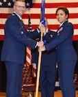 Col. Phil Heseltine, 931st Air Refueling Wing commander, hands the guidon to Lt. Col. Mei-Ling Taylor, incoming 931st Aerospace Medicine Squadron commander, during an assumption of command ceremony June 1, 2019, McConnell Air Force Base, Kan.  Previously, Taylor was the senior administrator for the 927th Aeromedical Staging Squadron at Macdill Air Force Base, Fla.