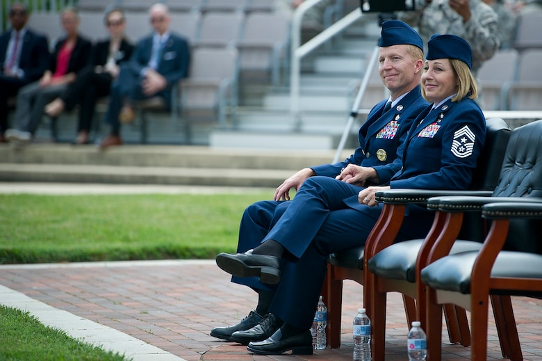 Chief Master Sgts. Melanie K. Noel, Air Force District of Washington command chief, right, and Michael D. Noel, Senior Enlisted Advisor to the Assistant to the Secretary of Defense for Public Affairs, listen to guest speakers during their combined retirement ceremony at Joint Base Anacostia-Bolling, Washington, D.C., May 31, 2019. (U.S. Air Force photo by Master Sgt. Michael B. Keller)