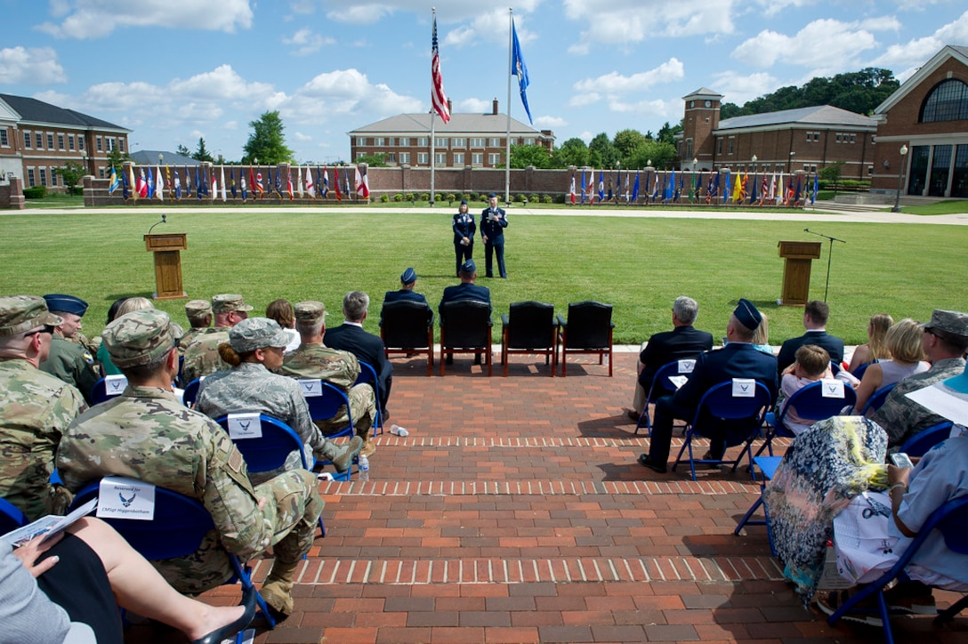 Chief Master Sgts. Melanie K. Noel, Air Force District of Washington command chief, left, and Michael D. Noel, Senior Enlisted Advisor to the Assistant to the Secretary of Defense for Public Affairs, speak to guests during their combined retirement ceremony at Joint Base Anacostia-Bolling, Washington, D.C., May 31, 2019. (U.S. Air Force photo by Master Sgt. Michael B. Keller)