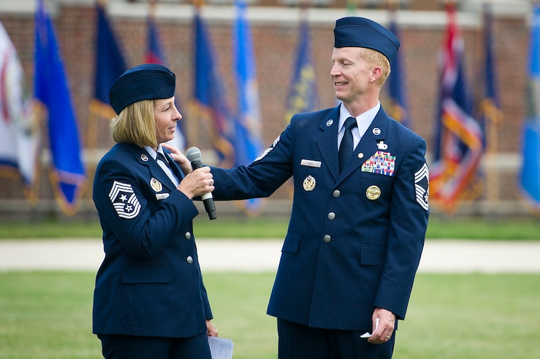 Chief Master Sgts. Melanie K. Noel, Air Force District of Washington command chief, right, and Michael D. Noel, Senior Enlisted Advisor to the Assistant to the Secretary of Defense for Public Affairs, give closing remarks during their combined retirement ceremony at Joint Base Anacostia-Bolling, Washington, D.C., May 31, 2019. (U.S. Air Force photo by Master Sgt. Michael B. Keller)