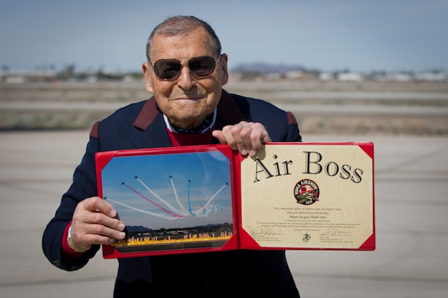 "Jacques-Andre Istel ""Mayor of Felicity"" poses with the 2019 Yuma Airshow Honorary Air Boss award at MCAS Yuma Ariz., Saturday, March 9, 2019. The airshow is MCAS Yuma's only military airshow of the year and provides the community an opportunity to see thrilling aerial and ground performers for free while interacting with Marines and Sailors. (U.S. Marine Corps photo by Lance Cpl. Joel Soriano)"