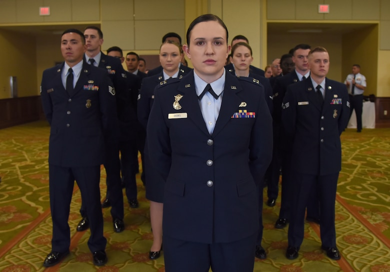 U.S. Air Force Capt. Samantha Giebel, 81st Security Forces Squadron operations officer, stands in formation during the 81st SFS change of command ceremony inside the Bay Breeze Event Center at Keesler Air Force Base, Mississippi, May 31, 2019. Maj. Matthew Lowe, incoming 81st SFS commander, assumed command from Lt. Col. Jonathon Murray, outgoing 81st SFS commander, with the passing of the guidon. The passing of the guidon is a ceremonial symbol of exchanging command from one commander to another. (U.S. Air Force photo by Kemberly Groue)